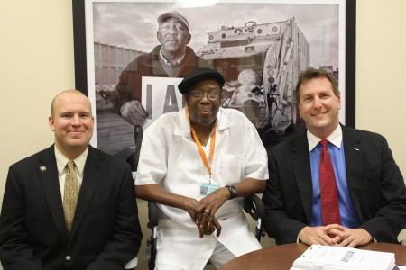 University of Miami law student Noel Pace, right, and alum Ryan Foley, left, helped U.S. Army veteran Hosea Smith, center, obtain Social Security disability payments. Smith is a leukemia patient of the Veterans Affairs Healthcare System in Miami.