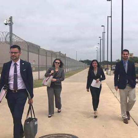 Professor Erica Schommer and St. Mary's students approach the court at the South Texas Detention Complex.
